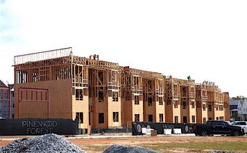 Work on three large commercial/residential buildings in the Town Center area of Pinewood Forest in Fayetteville is underway. Photo/Ben Nelms.