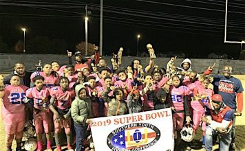 Sandy Creek Junior Patriots 11U football team marks a perfect 10-0 season with Super Bowl trophy. Photo/Shayla Wiggins.