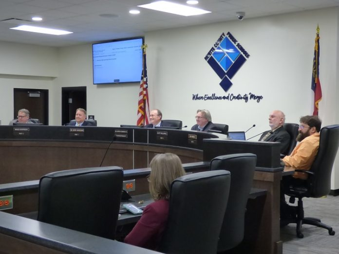 The Fayette County Board of Education on Nov. 4 voted 4-1 to build a $46 million replacement school for Booth Middle School in Peachtree City. Pictured, from left, are board members Brian Anderson and Barry Marchman, Superintendent Jody Barrow, Chairman Scott Hollowell, and board members Roy Rabold and Leonard Presberg. Photo/Ben Nelms.