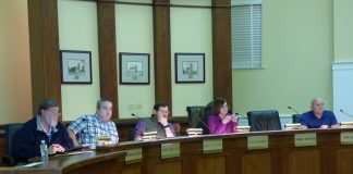 Members of the Fayetteville Planning and Zoning Commission on Nov. 19 recommending approval of a 48-lot subdivision on the city's south side included, from left, commissioners Ken Collins, Toby Spencer and Brett Nolan, Chairman Sarah Murphy and Commissioner Joe Clark. Photo/Ben Nelms.