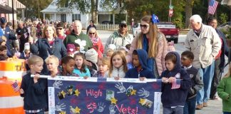 The students at Liberty Tech Charter School in Brooks made sure Veterans Day was a special event by holding a parade and live music downtown. Photo/Ben Nelms.