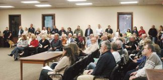 Peachtree City residents, most opposing the Great Wolf Water Park rezoning, crowded into City Hall in March 2015 to be heard. File photo.