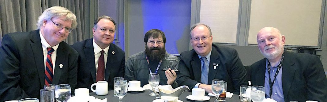 The Leading Edge Award was presented to the school system at an awards luncheon during the annual Georgia School Boards Association conference in Atlanta. (L-R) Fayette County Board of Education members Scott Hollowell (chairman), Dr. Barry Marchman, Leonard Presberg, Fayette County Public School Superintendent Dr. Joseph Barrow, and Fayette County Board of Education member Roy Rabold (vice-chair). Photo/Fayette County School System.
