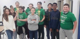 The academic team at J.C. Booth Middle show off their trophies after winning the Middle School Academic Bowl with an undefeated season. Photo/Fayette County School System.