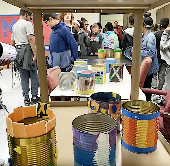 Empty aluminum food cans saved from the trash and turned into planters are ready for soil and plants. Photo/Fayette County School System.