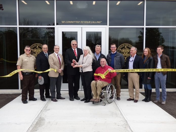 Present for the Dec. 12 ribbon cutting at the new Fayette County Sheriff's Office Shooting Range and Training Center on Hewell Road were, from left, Capt. Troy McCollum, Fayetteville Councilman Paul Oddo, Fayette County Commissioner Chuck Oddo, Fayette County Commission Chairman Randy Ognio, Maj. Michelle Walker, Fayette County Administrator Steve Rapson, Fayette County Commissioner Eric Maxwell, Project Manager Tim Symonds, K.A. Oldham Design representatives Kip Oldman and Lynda Alexander and Oak Construction representative Hampton Vann. Photo/Ben Nelms.