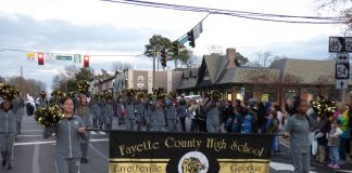 The Fayette County High School Tiger Band was one of the many entries at the Fayetteville Christmas Parade held Dec. 7. Photo/Ben Nelms.