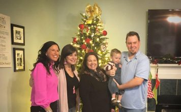 Atlanta nonprofit Join the Flock, Inc. on Dec. 21 presented a Newnan couple with a helping hand. Pictured, from left, are Join the Flock board members Dayna McJenkin and Katie Walton, Beth Johnson, 2-year-old Everett Johnson and Ryan Johnson. Photo/Submitted.