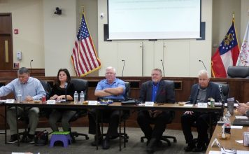 The Peachtree City Council on Dec. 3 held an informal meeting to talk about potential future goals. Pictured, from left, are, Councilman Mike King, Mayor Vanessa Fleisch and councilmen Terry Ernst, Kevin Madden and Phil Prebor. Photo/Ben Nelms.