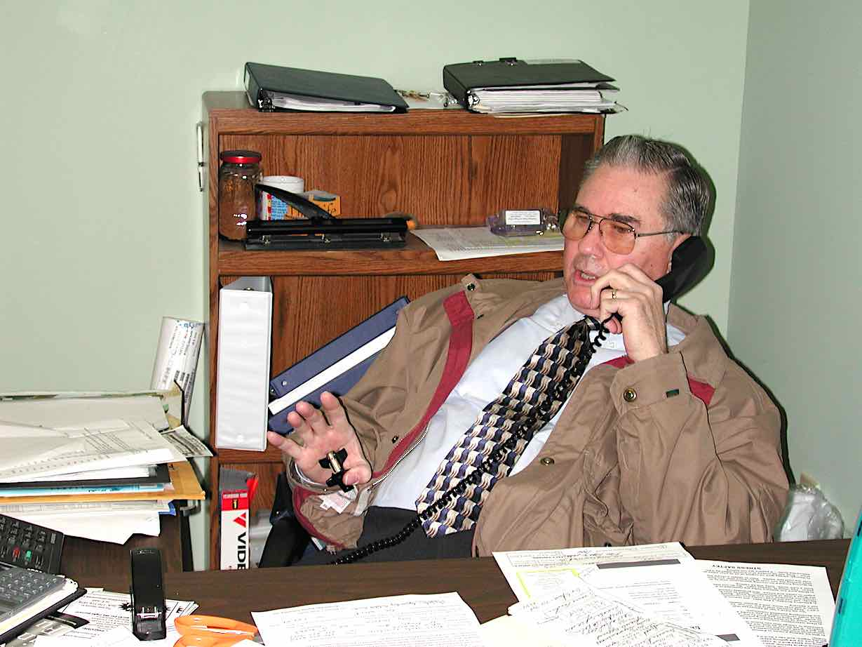 <b>Jack Wheeler at work as sales manager of The Citizen Newspapers, from his office in Fayetteville circa 2001.</b>