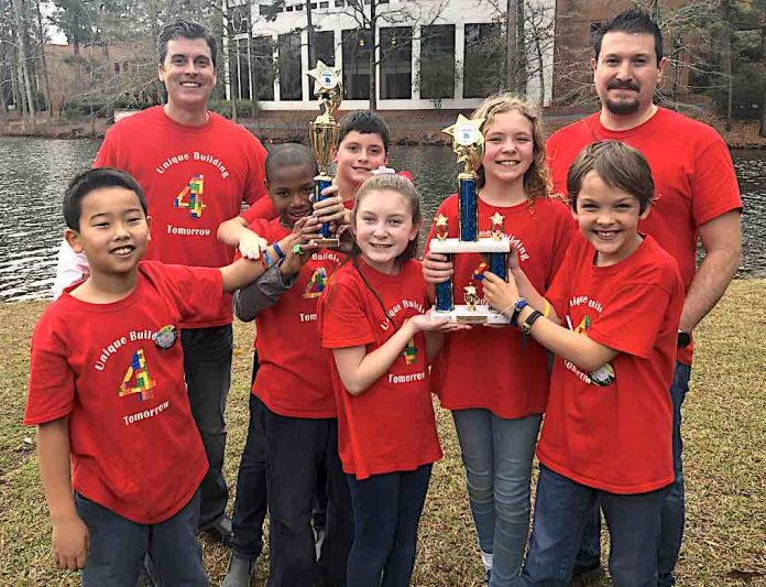 Crabapple Lane Elementary won the grand championship at the FIRST LEGO League Super Regional competition and are heading to the state competition in February. Team members (L-R) Masaya Misugi, Thomas Morrow, Corin Staples, Isabelle Sanchez, Ember Vlachos , and Mark Blahnik. Coaches are Patrick Staples and Jaime Sanchez. Photo/Fayette County School System.