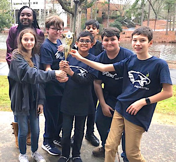 <b>Flat Rock Middle scored enough points at the FIRST LEGO League Super Regional competition to earn a spot in the state championship. Team members (L-R) Madison Lohr, Jya Lee, Gavin McClure, Devon Nandlal, Darion Nandlal, Jaden Torres, and Jack Jung. Not pictured: Melissa Lohr, coach, and Darryl Hutchinson, co-coach. Photo/Fayette County School System.</b>