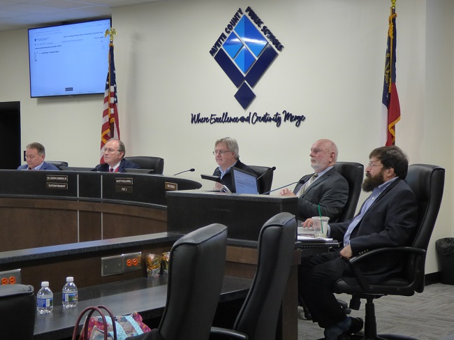 Present at the Jan. 21 meeting of the Fayette County Board of Education were, from left, board member Barry Marchman, Superintendent Jody Barrow, Chairman Scott Hollowell and board members Roy Rabold and Leonard Presberg. Board member Brian Anderson was not at the meeting. Photo/ Ben Nelms.