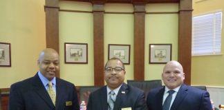Sworn in on Jan. 9 were, from left, Fayetteville Councilman Darryl Langford, Mayor Ed Johnson and Councilman Joe Clark. Photo/Ben Nelms.