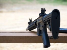 An AR-15 semi-automatic rifle on a bench rest. Shutterstock photo.