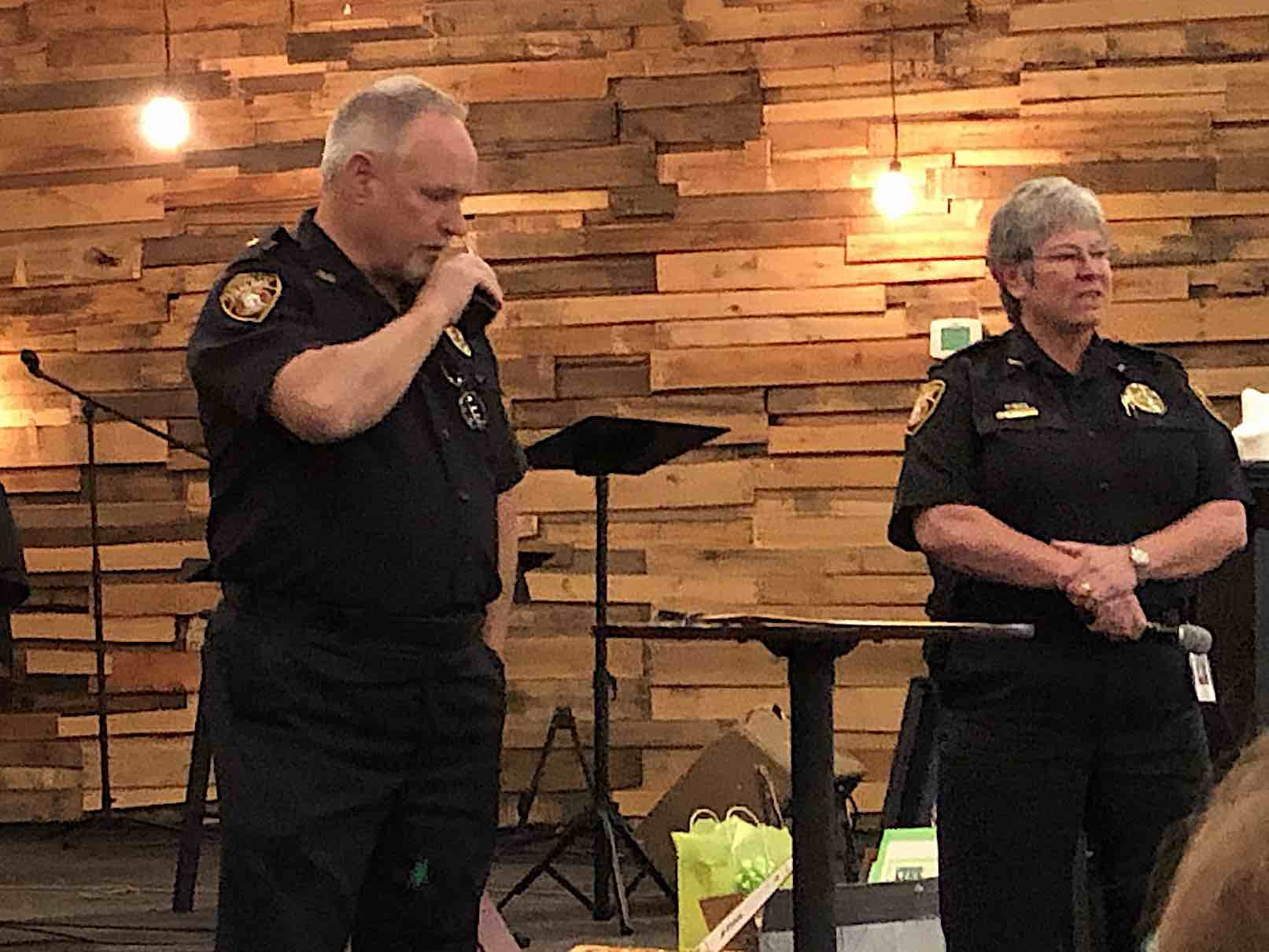 <b>Assistant Chief Stan Pye makes his final police radio call and signs off. Chief Janet Moon is at right. Photo/Cal Beverly.</b>