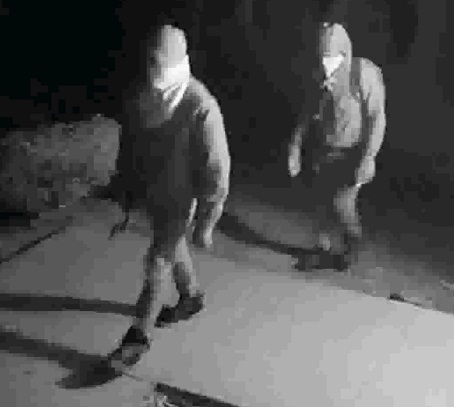 Fayetteville police are searching for these two men who burglarized a gun store on Feb. 10. Photo/Fayetteville Police Department.