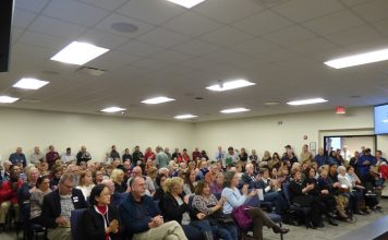 More than 200 people filled the meeting room at the Feb. 24 meeting of the Fayette County Board of Education. The vast majority opposed the proposed change to sex education curriculum. Photo/Ben Nelms.