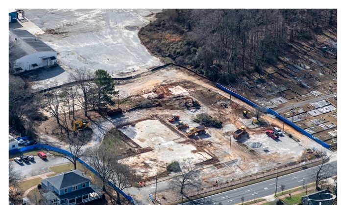 What was once the site of the school system central office on Stonewall Avenue in Fayetteville gave way to crews in January preparing the property for the new Fayetteville City Hall, expected to open next year. Photo/Comprehensive Program Services.