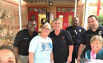 Spring Hill Elementary School staff and helpers prepare to distribute meals. Photo/Spring Hill Elementary School Facebook page.