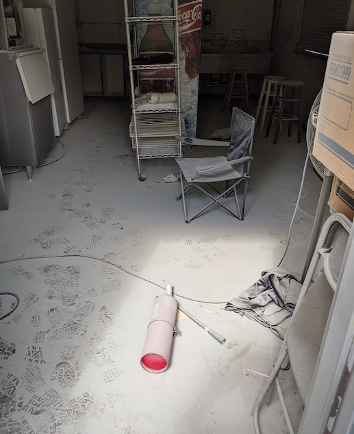<b> Vandals pulled the pin and expended a fire extinguisher inside a storage building at Riley Field. Photo/Peachtree City Police Department.</b>
