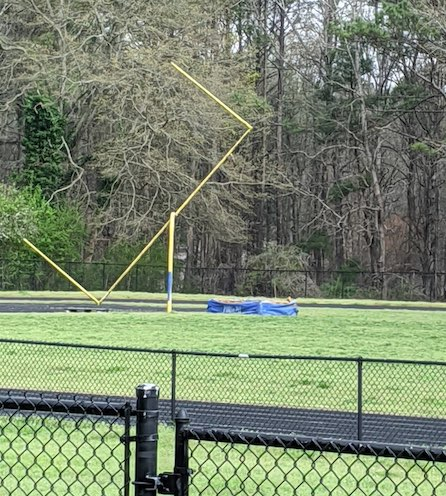 2 kids with a taste for destruction left this Riley Field goalpost in an unnatural position. Photo/Peachtree City Police Department.