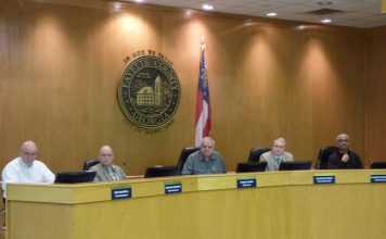 Voting to close Fayette County government offices to the public through March 27 were, from left, commissioners Eric Maxwell and Edge Gibbons, Chairman Randy Ognio and commissioners Chuck Oddo and Charles Rousseau. Photo/Ben Nelms.