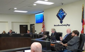 Members of the Fayette County Board of Education at the March 9 work session included, from left, board members Brian Anderson and Barry Marchman, Superintendent Jody Barrow, Chairman Scott Hollowell and board members Roy Rabold and Leonard Presberg. Photo/Ben Nelms.