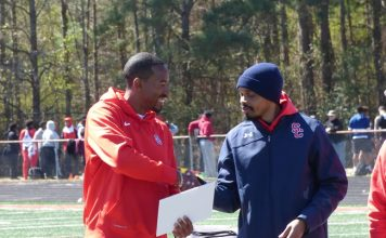 Olympic champion and world champion track and field athlete, and Sandy Creek High School graduate, Christian Taylor on March 7 was honored for his accomplishments at Sandy Creek High School stadium, where the Christian Taylor Invitational was held. Pictured with Taylor, at left, is Sandy Creek Head Track Coach Jeremy Easley. Photo/Ben Nelms.