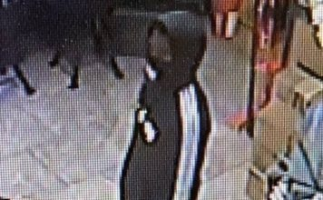 The photo shows one of the two men who robbed the Pit Stop on Ga. Highway 74 South in Peachtree City on March 28. Photo/Peachtree City Police Department.