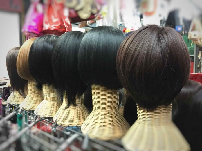 042220_wigs on display in Shutterstock photo.