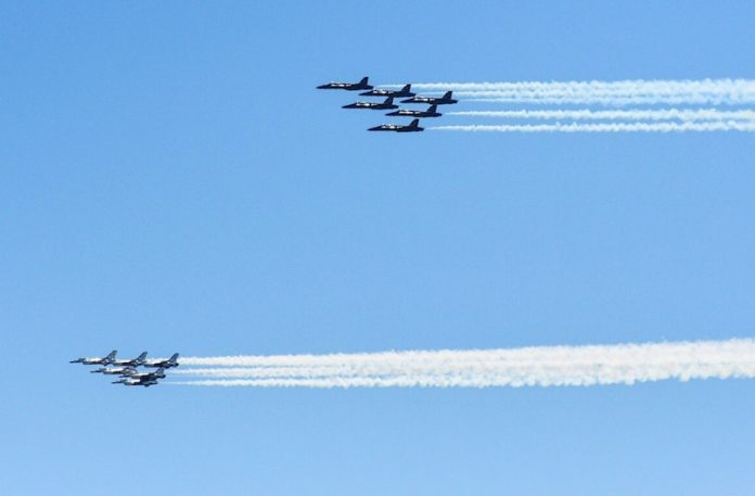 U.S. Navy's Blue Angels and U.S. Air Force's Thunderbirds join to honor Covid-19 workers.