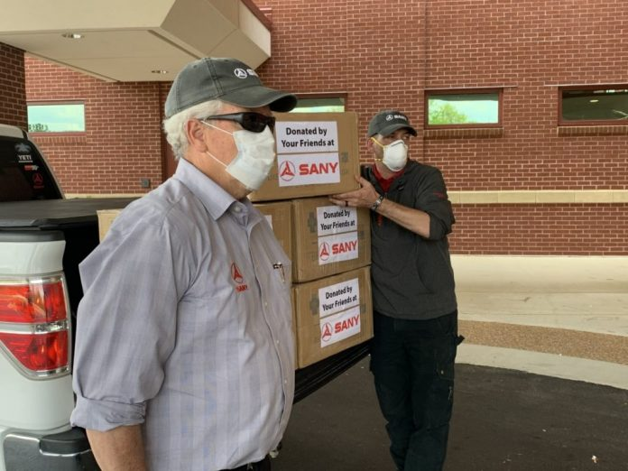 SANY team members Tom Cooper and Rob Nelson delivered masks to Piedmont-Fayette Hospital in Fayetteville, Ga. Photo/SANY America.