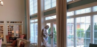 A Member of the Georgia National Guard's Covid-19 cleaning squad sanitizes an entranceway at Heritage of Peachtree. Photo/Submitted.