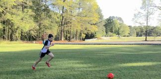 Matt Mazzanti, 14, practices his soccer skills in an empty field.