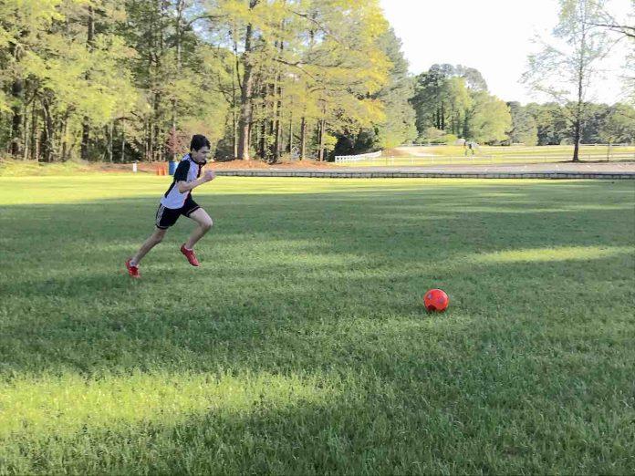 Matt Mazzanti, 14, practices his soccer skills in an empty field.