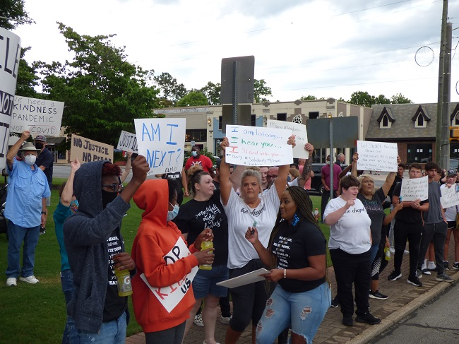 More than 200 people filled the sidewalks on both sides of Glynn Street in downtown Fayetteville on June 5, protesting the death of black lives at the hands of law enforcement. Met with the honking of hundreds of horns from passing vehicles showing solidarity, the group arrived at the site after holding a brief rally at the adjacent county complex. Photo/Ben Nelms.