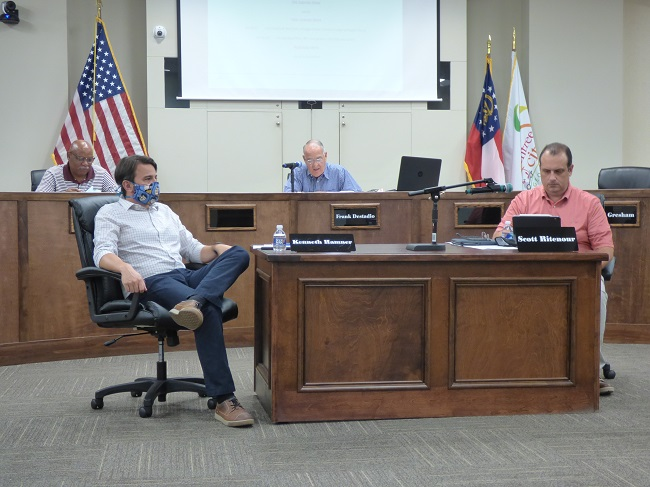 The Home2 Suites by Hilton hotel to be located off Ga. Highway 74 South and Crosstown Drive was approved June 8 by unanimous vote by the Peachtree City Planning Commission. Members at the meeting included, (in front, from left) Kenneth Hamner and Scott Ritenour and (in rear, from left) Commissioner Michael Link and Chairman Frank Destadio. Photo/Ben Nelms.
