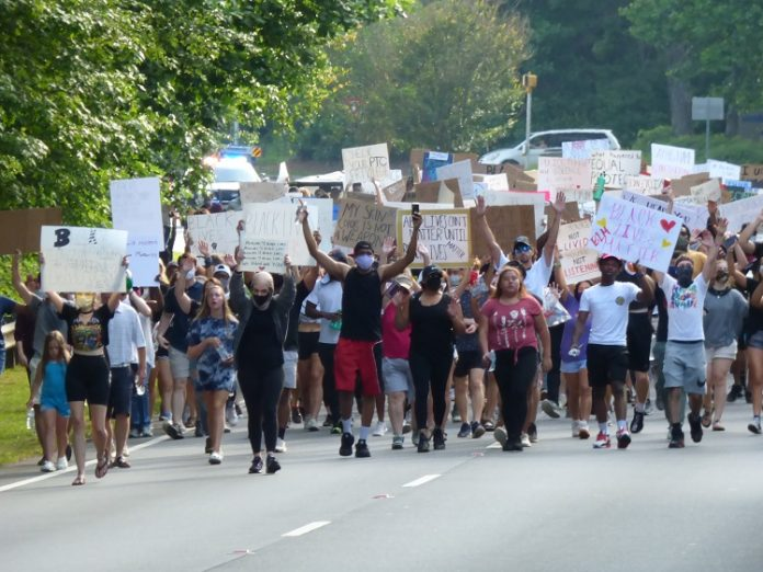 A group of 400 people protesting the loss of black lives to law enforcement marched along Ga. Highway 54 in Peachtree City during the afternoon hours of June. 2. The peaceful protest began at The Avenue and ended at City Hall Plaza. Photo/Ben Nelms.