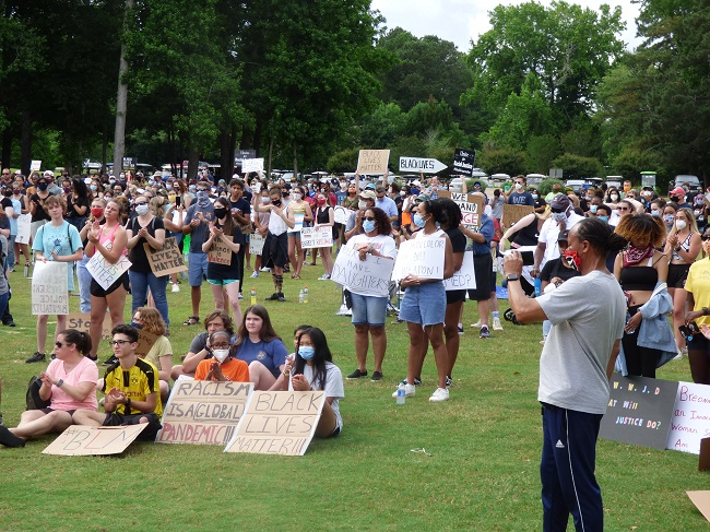 The photo above shows a portion of the group of 600 people who arrived at Drake Field in Peachtree City on June 7 to attend a protest initiated by McIntosh High School rising sophomore Kaitlyn Hood. The aim of the protest was to bring awareness to the black lives lost in encounters with law enforcement. Photo/Ben Nelms.