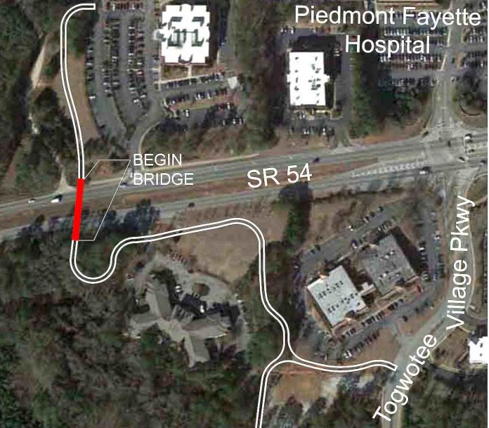 Aerial view of the route planned for the multi-use path and bridge across Ga. Highway 54 adjacent to the Piedmont Fayette Hospital. The path leads past Togwattee Village and connects to Bennett's Mill Middle School. Graphic/City of Fayetteville.