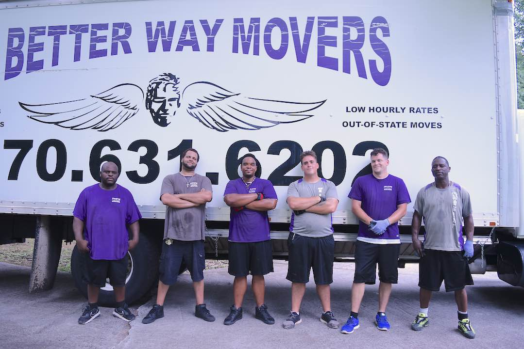 <b>A Better Way Movers crew stand together at the end of a long day of moving a widow and her son into their first home in four years. It was a 2-truck all-day job that was performed at no charge to the family. Photo/Cal Beverly.</b>