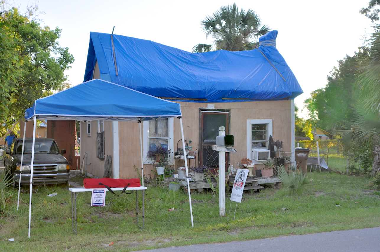 <b>The Before — the home was habitable but only because of the temporary tarps that replaced the blown-away roof. All photos/Square Foot Ministries.</b>