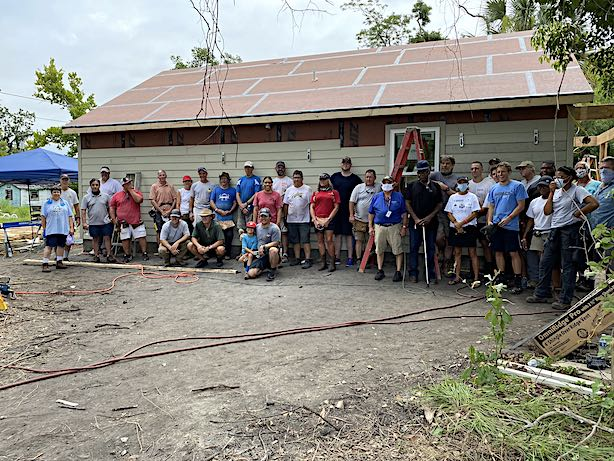 <b> The workers pose for a group portrait. At far left are Jeff Williams (Executive Director) in the white shirt and that's Maggie Clark in the blue shirt.</b>