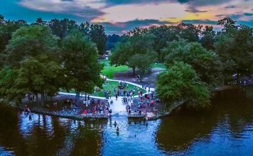 """People began to gather before sunset at Drake Field in Peachtree City on July 4 for the """"Free the 4th"""" protest over the postponement of the annual fireworks display. Photo/Adam Black."""