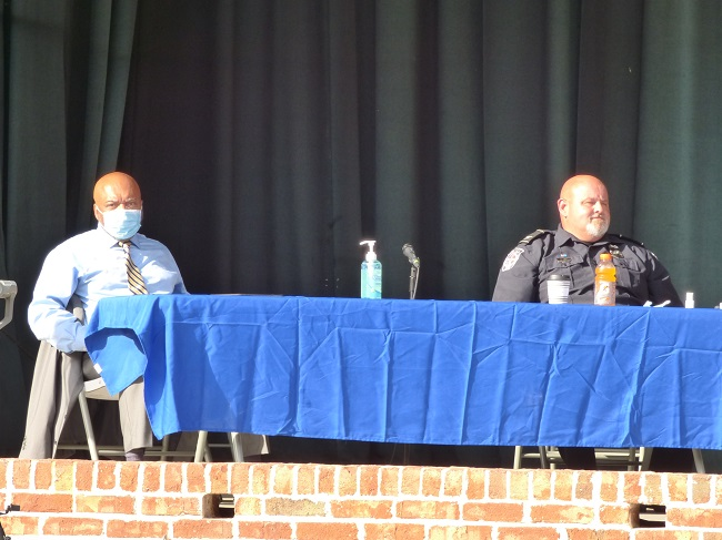 <b>Civil rights attorney Wayne Kendall (L) and Fayetteville Police Chief Scott Gray were part of a panel about racial matters and policing. Photo/Ben Nelms.</b>