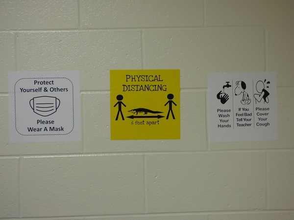 <b>Signs in Fayette County public school hallways will display health and safety precautions. Photo/Ben Nelms.</b>