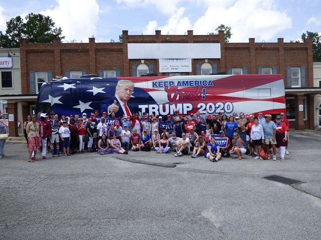 <b>A portion of the 300 people attending the All-American Rally for Trump on Aug. 1 in Fayetteville took time out with the Trump bus at the Fayette County GOP Event Center. Photo/Ben Nelms.</b>