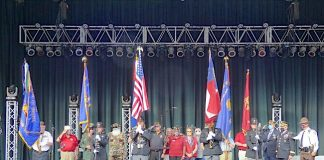 Members of local veterans' groups, along with the Fayette County Sheriff's Honor Guard, presented colors at the outset of the 9/11 tribute. Photo/Ben Nelms.