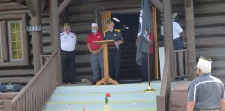 "A group of veterans from around Fayette County met Sept. 18 at the American Legion Log Cabin in Fayetteville for the annual POW/MIA Recognition Day, in the hope that people of this nation will ""Never Forget"" the service and sacrifice of those who never retuned home. Photo/Ben Nelms."